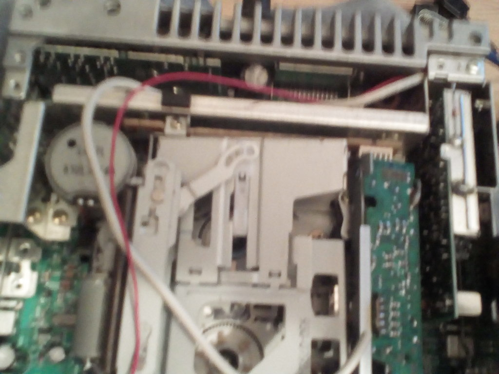 AND SOLDERED THE WIRES 3 FOR AUDIO AND ONE FOR RADIO ANTENNA.   FEED THE WIRES INTO THE TOP HALF OF THE UNIT LIKE THIS